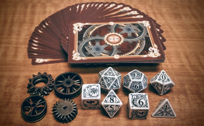 Photo of steampunk Action Deck, bennies, and dice